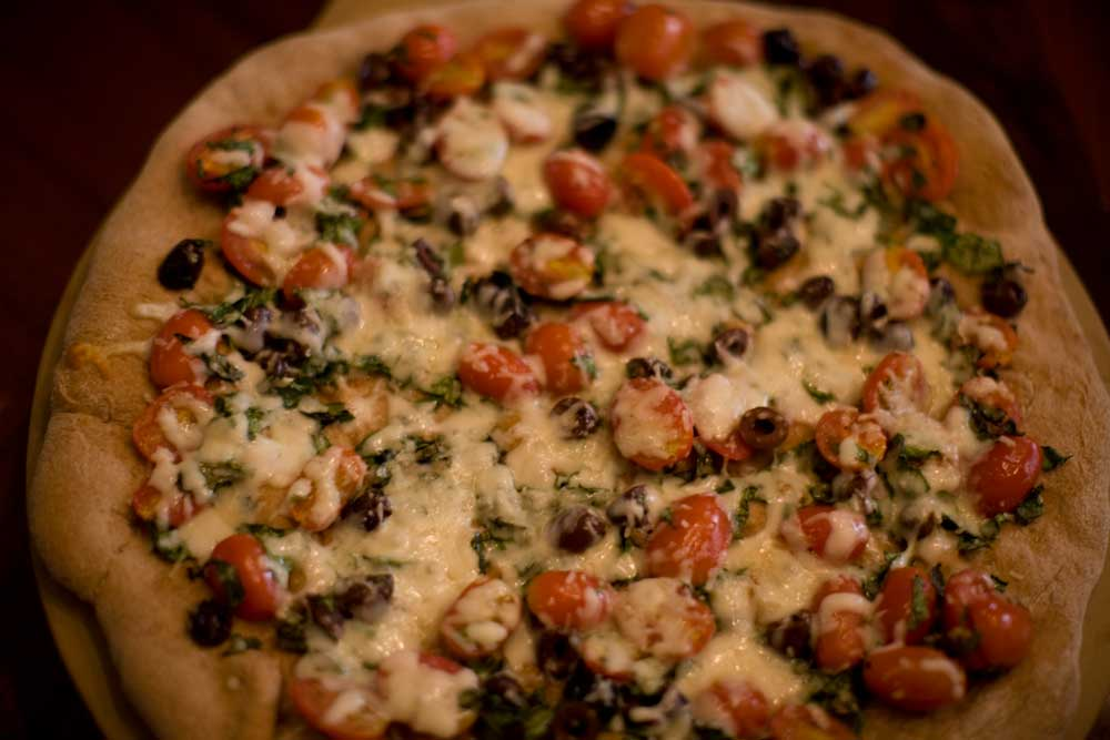 Spinach Tomato Olive Pizza
